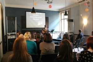 Nicole leading worship at a women's seminar