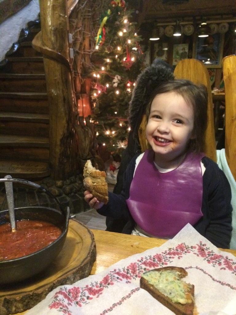Nora eating red borscht